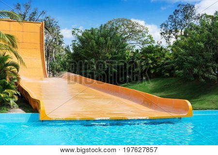 yellow water slides in tropical aquapark