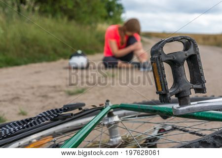 Young Woman Fallen From Mountain Bicycle