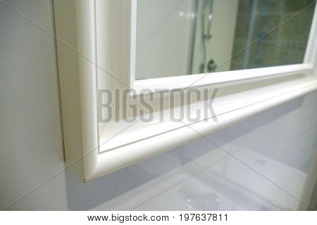 Detail Of A White Mirror Frame In The Bathroom