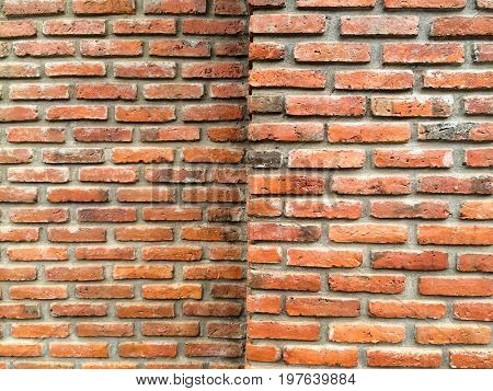 Old brick wall corner background textured.red brick wall texture grunge background textured for vignetted corners or interior design.