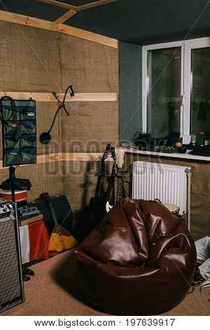 Equipment for old recording music studio. Old-fashioned place, garage with musical instruments
