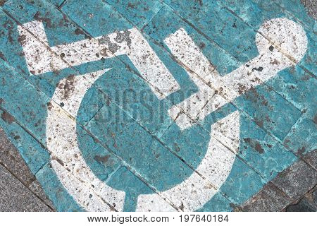 Disability symbol painted on the floor. It can be use as background.