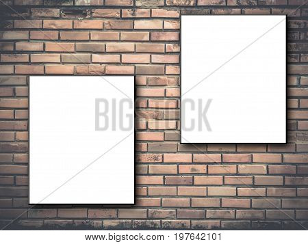 Two blank, white canvas frames hang on brick wall.Two blank billboards attached to a buildings exterior brick wall.