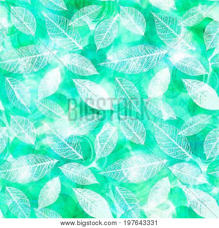 A seamless background pattern of skeleton leaves on a texture of abstract teal blue watercolor brush strokes, autumnal repeat print