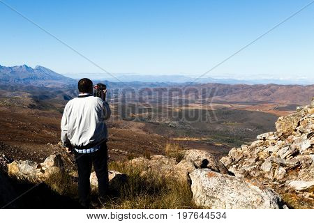 Man Standing And Admiring The Swartberg Mountains