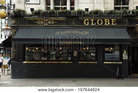LONDON, UK - JUNE 5 , 2017:Pub is an establishment licensed to sell drinks which traditionally include beer ale and cider. It is a relaxed social drinking establishment and a prominent part of British