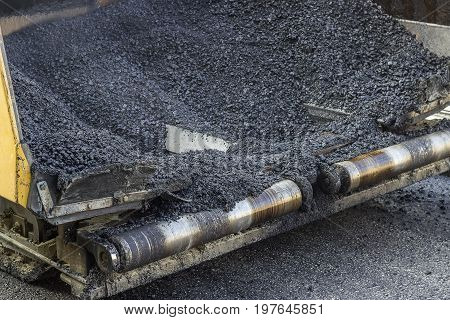 Hot Asphalt In Paver Machine