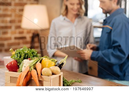 Best service in town. Committed lively nice man asking the lady signing some papers for confirming the delivery of the vegetables she ordering