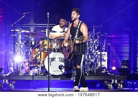 TWIN LAKES, WI - JUL 22: Singer Thomas Rhett performs during the 2017 Country Thunder Music Festival on July 22, 2017 in Twin Lakes, Wisconsin.