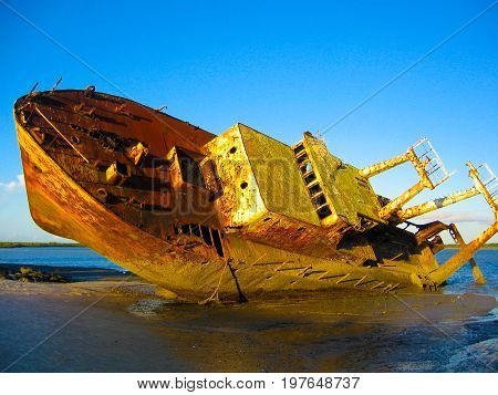 An old grounded shipwreck on a beach in Mozambique