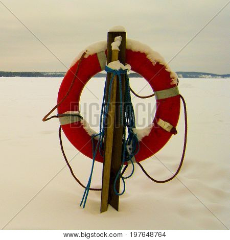 Life-ring and a frozen lake in Finland