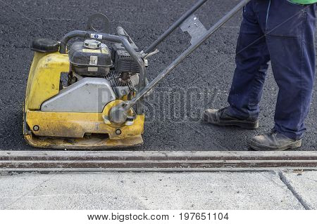 Road Repairing With Vibrating Compactor Plate