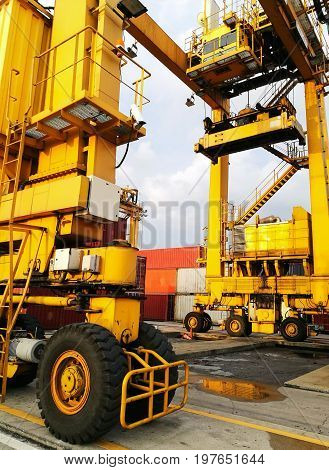 Close Up Wheel Rubber Tried Gantry Cranes (RTG) At Industrial Port