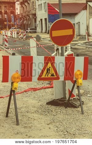 Road Under Construction With Warning Signs