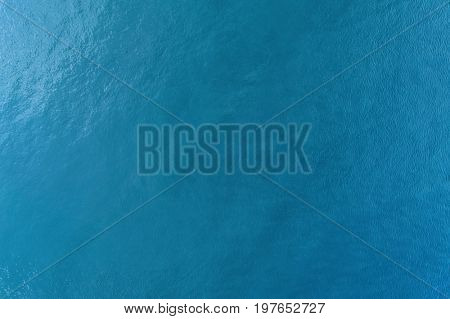 Vast blue ocean background with moderate waves directly above
