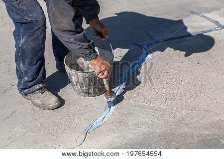 Worker Apply Layer Of Bonding Adhesive 2