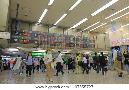TOKYO JAPAN - JULY 11, 2017: Unidentified people commute at Shinjuku train station. Shinjuku train station is the busiest train station in the world used by more than 2 million people every day.