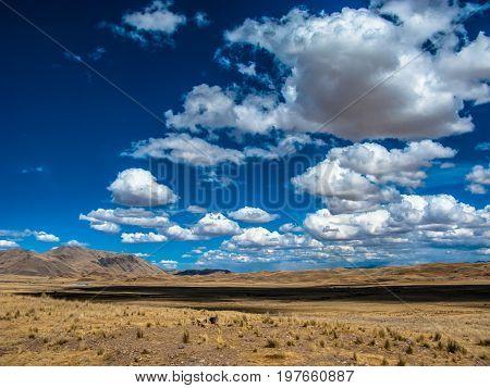 Blue sky with clouds in the roads of Puno Peru