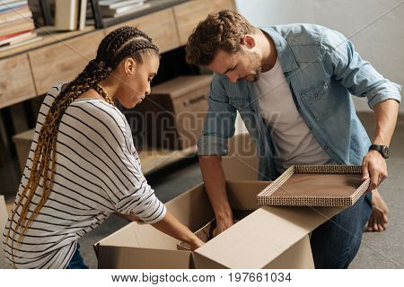 Put it inside. Serious people sitting on the floor and collecting their thing into box while going to change their flat