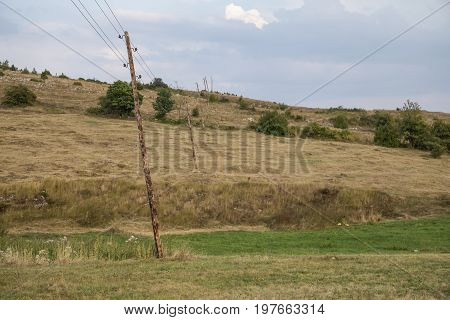 Leaning Wooden Electrical Poles With Wires 2