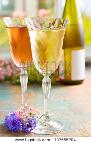 Cold Summer Wines, White And Rose, Served In Beautiful Glasses On The Fresh Air, Outdoor In The Gree