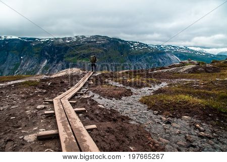 People walk the trail to Troll's Tongue Trolltunga rock in Hordaland county, Norway. The 22km trail to Trolltunga is among most visited in Norway.