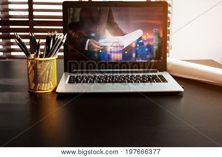 Business computer concept.Comfortable working place. Laptop with blank screen on table.