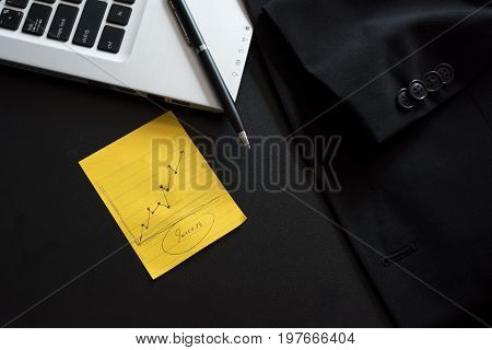 Business computer with note paper on table