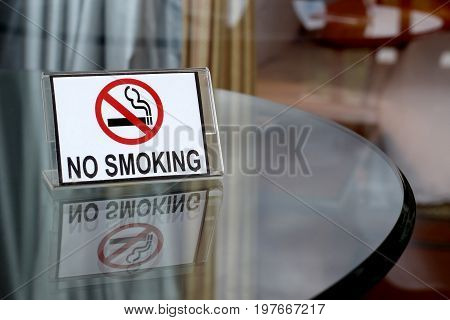 No Smoking Sign On Wooden Table