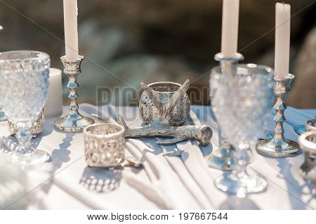 Glasses on the table. Festive table setting. Wedding decor. Table setting in fine art style. Table decor. Catering wedding ceremony selective and soft focus series