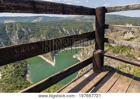 River Meander Between Defocused Wood Bars