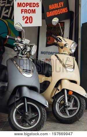 Honolulu Hawaii USA - May 25 2016: Mopeds for hire in downtown Waikiki