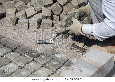 Worker Installing Granite Cubes 3