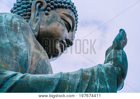 Tian Tan Buddha with details of hand - The worlds's tallest outdoor seated bronze Buddha located in Lantau Island, Hong Kong, China.