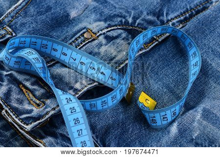 Blue Measure Tape On Jeans Crotch As Design Concept