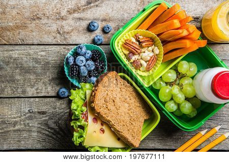 Healthy school lunch box on rustic background, copy space