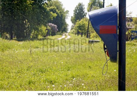public telephone in the countryside a summer day