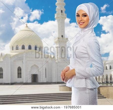 Young muslim woman at mosque background