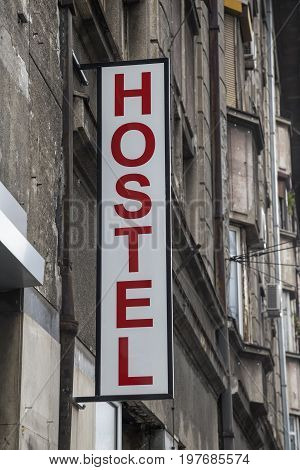 Hostel Sign On An Old Building 2