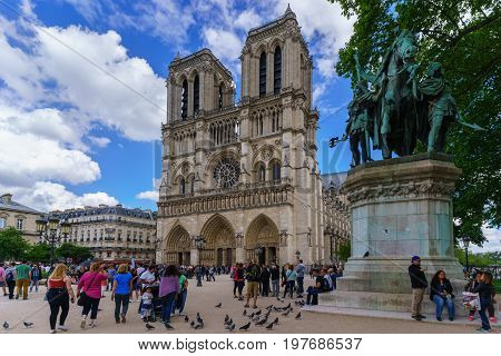 Paris France - May 13 2017 : The famous Cathedral Notre-Dame de Paris French Gothic architecture is one of the most well-known church in the world