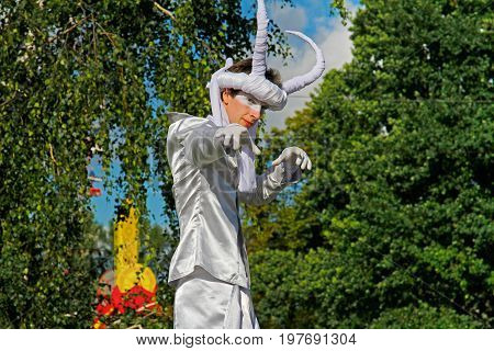 Moscow Russia - August 01 2015: Portrait of street actor with horns on stilts at the festival