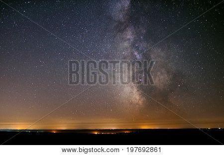 The center of our home galaxy, the Milky Way rising over the field, the night stars landscape