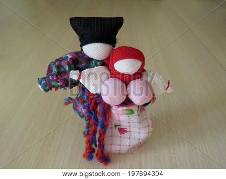Two Russian homemade rag dolls standing on a table