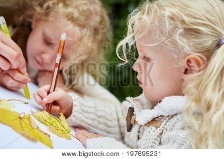 Children painting and drawing and making hadicrafts in kindergarten