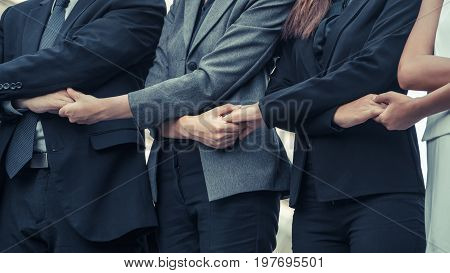 Business People Holding Hands Showing Teamwork.