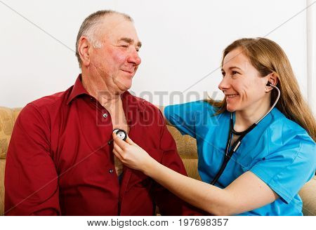 Physical examination of the cardiovascular system with stethoscope of elderly man