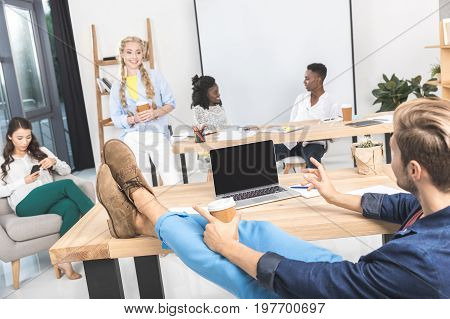 Multicultural Group Of Business Coworkers Discussing Work During Seminar In Office