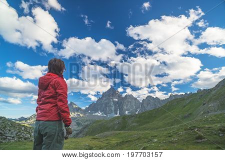 One Person Looking At The Majestic View Of Glowing Mountain Peaks At Sunset High Up On The Alps. Rea