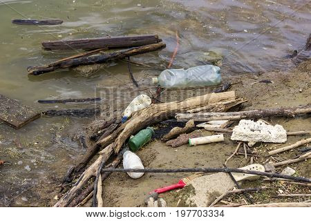 Plastic Bottles And Garbage Waste On The Shore 3