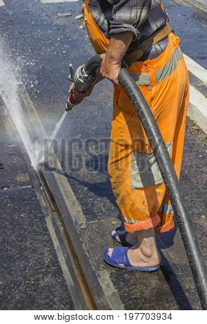 Road Worker Wearing Slippers And Using Water Jet 2